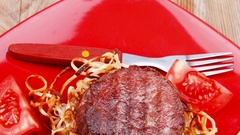 Fillet medallions on noodles with red hot chili pepper Stock Footage