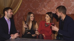 Two amorous couples celebrating together at restaurant Stock Footage