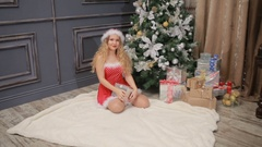 Young sexy girl in a Santa Claus Christmas tree Stock Footage