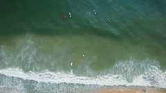 High angle view of surfers in ocean waves Stock Footage