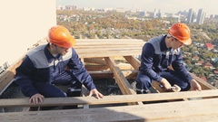 Two worker on the wood roof Stock Footage
