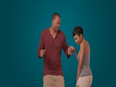 An African American couple dance on a blue background Stock Footage
