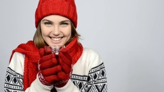 Winter girl in red warm knitted hat and scarf holding cup of tea Stock Footage