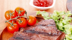 Juicy grilled beef meat steak fillet with marks on wood Stock Footage