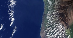 High-altitude overflight aerial of the southwestern coast of Hawaii Stock Footage