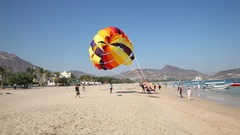 Parasailing on the beach in Khorfakkan, UAE Stock Footage