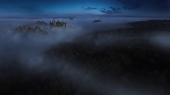 Aerial shot – Fantasy Castle in a foggy forest at night Stock Footage