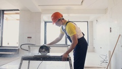 Worker and tile cutting machine Stock Footage