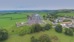 Closer look of the Rock of Cashel and the trees around in Ireland Stock Footage