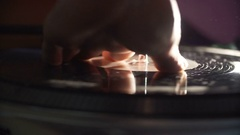 Man's hand scratching vinyl record Stock Footage