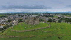 Aerial view of the Rock of Cashel in the hill in Ireland Stock Footage