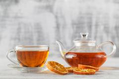 DIY winter composition with dried orange, tea glass Stock Photos