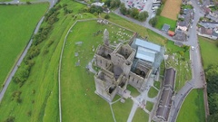 The big Rock of Cashel in an aerial view in Ireland Stock Footage