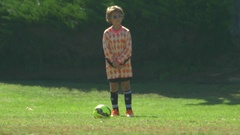 A goalie playing youth soccer football on a green field. Stock Footage