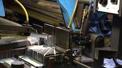 Hacksaw machine cuts metal Stock Footage