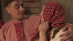 The girl in the Russian traditional suit sings the song to the groom Stock Footage