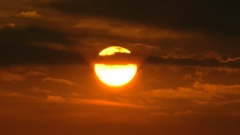 The sun and clouds after a cyclone. Evening, sunset. Crimson shade. Stock Footage