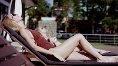 Attractive girls taking sun bath and enjoying summer Stock Footage