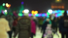 Concept Winter. Crowd at Night Skating Rink. Falling Snow. Christmas Star Blure Stock Footage