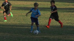 A boy falls while playing youth soccer football. Stock Footage