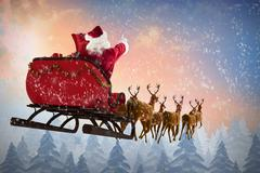 Composite image of santa claus riding on sleigh during christmas Piirros
