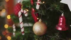 Close up shot of golden ball on the christmas tree bokeh backround, new year Stock Footage