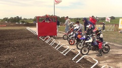 Kids racing in a motocross motor sports race, slow motion. Stock Footage