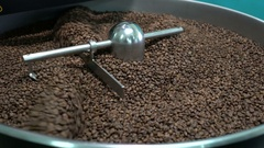 Roasted coffee beans in a coffee roaster Stock Footage