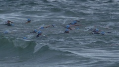 Athletes compete in the ocean swimming part of a triathlon. Arkistovideo