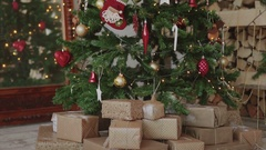 Close up shot of christmas presents and gifts under new year tree Stock Footage