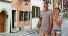 A black couple on vacation in Venice Italy stop to embrace Stock Footage