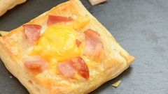 Fresh baked ham cheese and egg breakfast mini pies Stock Footage