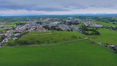 Aerial shot of the green fields from Rock of Cashel in Ireland Stock Footage