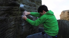 Detail of a young man's hand while he climbs boulders while bouldering. Stock Footage