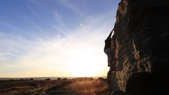 Silhouette of a man climbing boulders while bouldering. Stock Footage