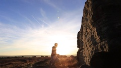 Silhouette of a man climbing boulders while bouldering, time-lapse. Stock Footage