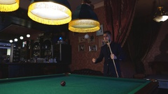 Handsome serious man playing pool Stock Footage