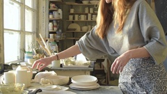 Young freelance ceramist looks at the results of their work Stock Footage