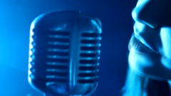Girl Singing Into Microphone On Stage with smoke Stock Footage