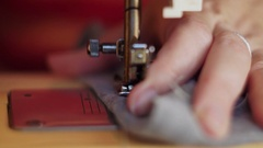 Close-up The tailor sewing on the sewing machine Stock Footage