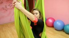Anti-gravity Yoga, athletic woman Stock Footage