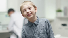 In the Doctor Office. Close-up of a Smiling Boy on a Blurry Background. Stock Footage