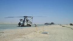 Marine crew loading chopper Stock Footage