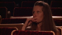 The missing girl in the empty auditorium Stock Footage