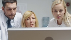 Group of Three Medical Specialists Solving Problems at the Desktop Computer. Stock Footage
