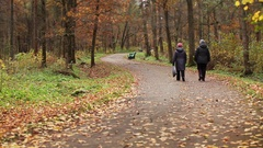 Retirees walking youth jogging Stock Footage