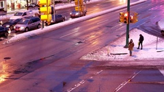 Top shot of pedestrian crossing stree and traffic flow on cold winter day Stock Footage