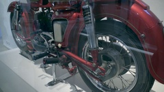 Old vintage red motorbike shock absorber test Stock Footage