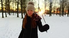 One woman with big sparkler stick, show glisten fireworks to camera, slowmo Stock Footage