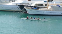 4K Crew Boat Team Rowing in Marina Sea Piraeus harbour harbor area Athens Athina Arkistovideo
